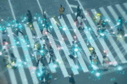 Smart city-blurry background of people crossing street